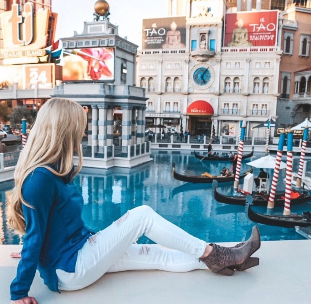 A woman looking at the gondolas in front of the Venetian Las Vegas