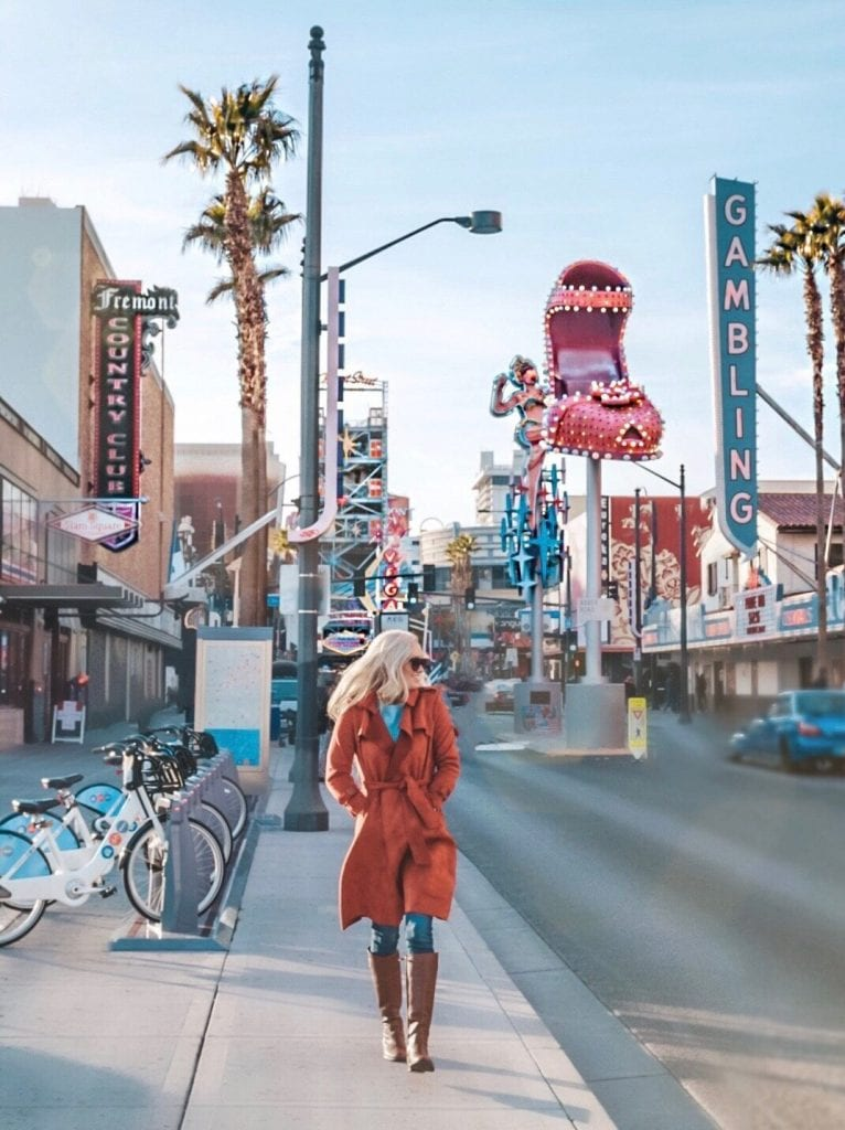 A woman walking down Fremont Street in Las Vegas