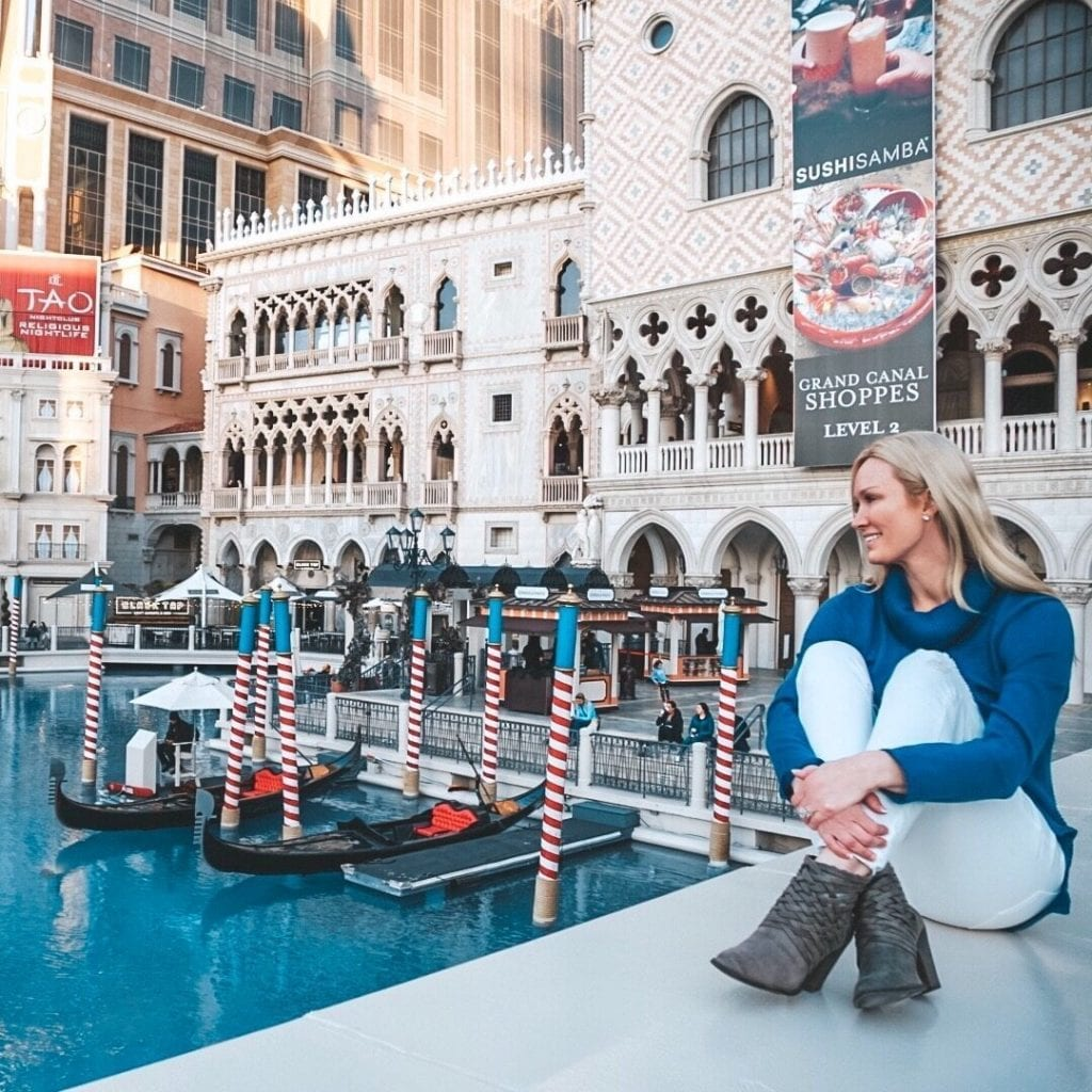 A woman sitting on the edge of the water at the Venetian Las Vegas