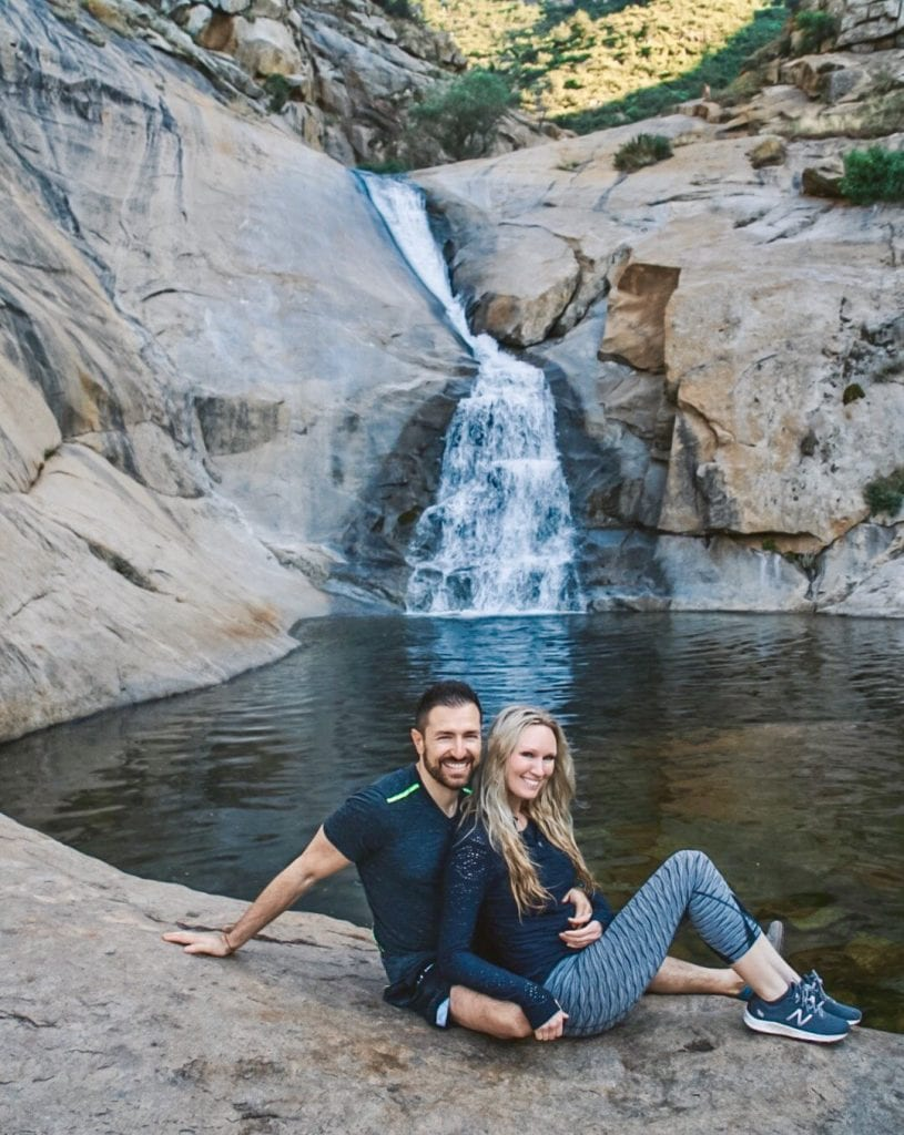 Couple in front of Three Sisters Falls, one of the best waterfalls in San Diego