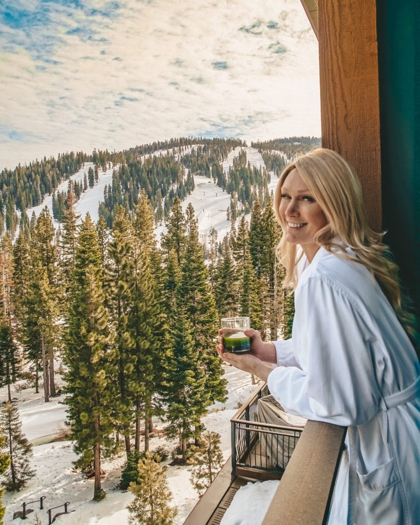A woman enjoys the balcony view at the Ritz Carlton in Lake Tahoe