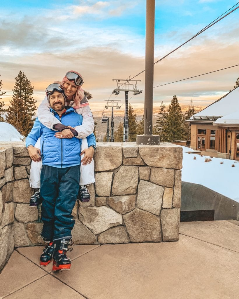 A couple by the ski lift at the Ritz Carlton Lake Tahoe