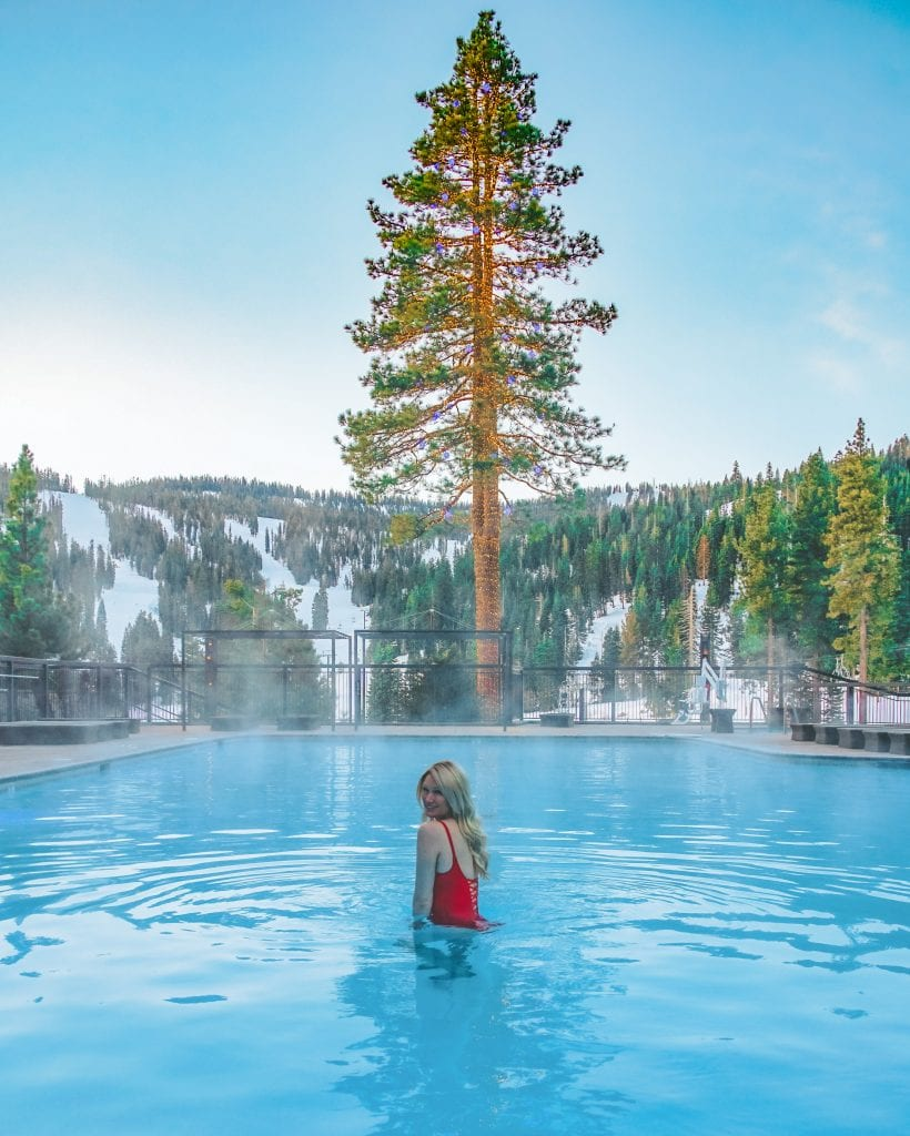A woman in the heated pool at the Ritz Carlton Lake Tahoe